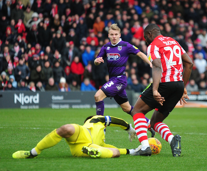 Lincoln City's John Akinde is denied a chance by Grimsby Town's James McKeown<br /> <br /> Photographer Andrew Vaughan/CameraSport<br /> <br /> The EFL Sky Bet League Two - Lincoln City v Grimsby Town - Saturday 19 January 2019 - Sincil Bank - Lincoln<br /> <br /> World Copyright © 2019 CameraSport. All rights reserved. 43 Linden Ave. Countesthorpe. Leicester. England. LE8 5PG - Tel: +44 (0) 116 277 4147 - admin@camerasport.com - www.camerasport.com