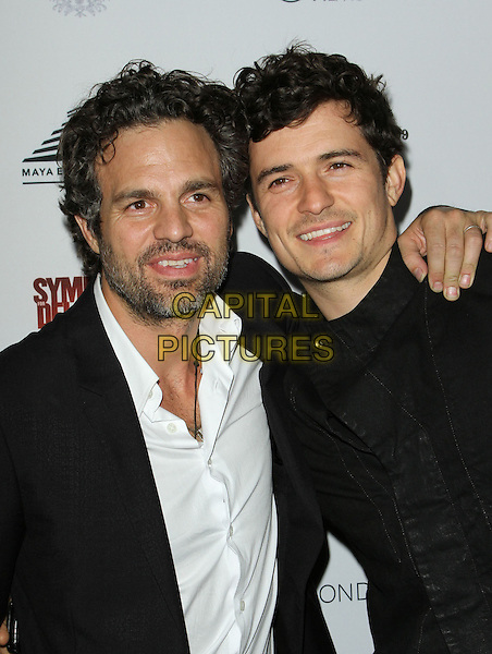 "MARK RUFFALO & ORLANDO BLOOM .""Sympathy for Delicious"" Release Party held at the Mondrian Hotel's SkyBar,.West Hollywood, California,.27th April 2011..half length black white shirt beard facial hair jacket arm around .CAP/ADM/KB.©Kevan Brooks/AdMedia/Capital Pictures."