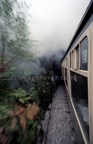 "Historic image from the 1980's of the famous journey by steam train from Fort William to Mallaig in Scotland / UK. No releases available. --- Info: In 1984 when British Rail reintroduced steam to the line it was known as ""The West Highlander"" which later became ""The Lochaber"". After ""West Coast Railways"" took over the running of this service in 1995 the line name became ""The Jacobite"". The train ride is regarded as one of the Great Railway Journeys of the World, due mainly to the stunning scenery. One of the highlights of the journey is passing over the Glenfinnan Viaduct- one of the largest concrete engineering feats of the late 19th century - and nowadays well known for appearing in the Harry Potter films."