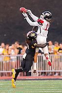 Baltimore, MD - SEPT 10, 2016: St. Francis (Pa) Red Flash wide receiver Kamron Lewis (11) goes up for a pass over Towson Tigers cornerback Justice Pettus-Dixon (17) during their match up at Johnny Unitas Stadium in Baltimore, MD. The Tigers defeated St. Francis 35-28. (Photo by Phil Peters/Media Images International)