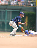 Marcus Giles of the San Diego Padres vs. the Chicago Cubs as Felix Pie slides in face first: June 18th, 2007 at Wrigley Field in Chicago, IL.  Photo copyright Mike Janes Photography 2007.