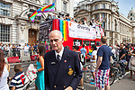 "© Joel Goodman - 07973 332324 - all rights reserved . 03/07/2010 . London , UK . A man wearing a badge in support of Clause 28 ( Section 28 ) and another that says "" Jesus Saves "" turns his back on a "" Diversity Bus "" on Whitehall . Annual London Pride march and demonstration through the centre of London . Photo credit : Joel Goodman"