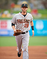 Reid Brignac (28) of the Fresno Grizzlies between innings  against the Salt Lake Bees in Pacific Coast League action at Smith's Ballpark on April 17, 2017 in Salt Lake City, Utah. The Bees defeated the Grizzlies 6-2. (Stephen Smith/Four Seam Images)