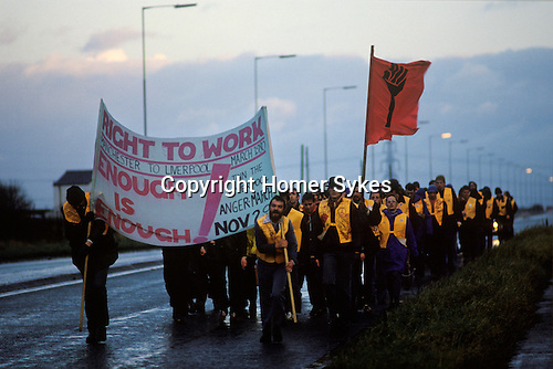 The People's March for Jobs Right to work march Manchester to Liverpool. March 29th  1981 UK England. Walk through night