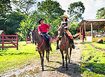 Family members enjoy an afternoon of horseback riding in the canton of Sarapiqui.  Costa Ricans love their horses and have a long equestrian history descended from their Spanish ancestors.