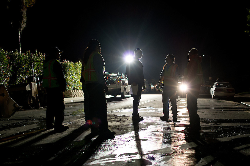 A construction crew works late into the night to repair a broken underground water main which burst after a 6.1 magnitude earthquake hit the San Francisco Bay Area at 3:20 am, in Napa, California, USA, 24 August 2014. More than 70 people were sent to hospital with injuries and power outages darkened multiple cities in northern California after a 6.1-magnitude earthquake struck early on 24 August. The United States Geological Survey (USGS) said the earthquake struck at 3:20 am (1020 GMT) at a depth of 10.8 kilometres. It was located nine kilometres south-west of the Napa wine region, and 81 kilometres north of San Francisco.
