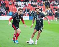 Lincoln City's Harry Toffolo, left, and Bruno Andrade during the pre-match warm-up<br /> <br /> Photographer Andrew Vaughan/CameraSport<br /> <br /> The EFL Sky Bet League One - Lincoln City v Sunderland - Saturday 5th October 2019 - Sincil Bank - Lincoln<br /> <br /> World Copyright © 2019 CameraSport. All rights reserved. 43 Linden Ave. Countesthorpe. Leicester. England. LE8 5PG - Tel: +44 (0) 116 277 4147 - admin@camerasport.com - www.camerasport.com