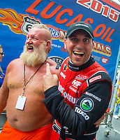 Jul 12, 2015; Joliet, IL, USA; NHRA top fuel driver T.J. Zizzo reacts next to a shirtless fan prior to the Route 66 Nationals at Route 66 Raceway. Mandatory Credit: Mark J. Rebilas-USA TODAY Sports