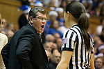 17 December 2013: UConn head coach Geno Auriemma (left) complains to referee Maj Forsberg (right). The Duke University Blue Devils played the University of Connecticut Huskies at Cameron Indoor Stadium in Durham, North Carolina in a 2013-14 NCAA Division I Women's Basketball game. UConn won the game 83-61.