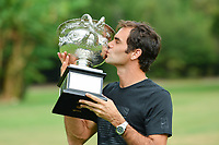 January 29, 2018: The 2018 Australian Open champion Roger Federer of Switzerland pose for photographs with his trophy at Government House in Melbourne, Australia. Federer beat Cilic 3 sets to 2. Photo Sydney Low