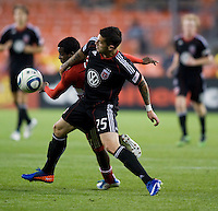 Santino Quaranta (25) of D.C. United fights for the ball with Marvin Chavez (18) of FC Dallas during the game at RFK Stadium in Washington, DC.  D.C. United tied FC Dallas, 0-0.