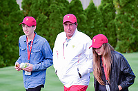 Phil Mickelson (USA) and his two kids depart the 4th tee as they follow Justin Thomas (USA) and Daniel Berger (USA) during round 3 Four-Ball of the 2017 President's Cup, Liberty National Golf Club, Jersey City, New Jersey, USA. 9/30/2017.<br /> Picture: Golffile | Ken Murray<br /> <br /> All photo usage must carry mandatory copyright credit (&copy; Golffile | Ken Murray)