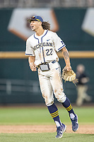 Michigan Wolverines outfielder Jordan Brewer (22) celebrates after beating the Vanderbilt Commodores in Game 1 of the NCAA College World Series Finals on June 24, 2019 at TD Ameritrade Park in Omaha, Nebraska. Michigan defeated Vanderbilt 7-4. (Andrew Woolley/Four Seam Images)