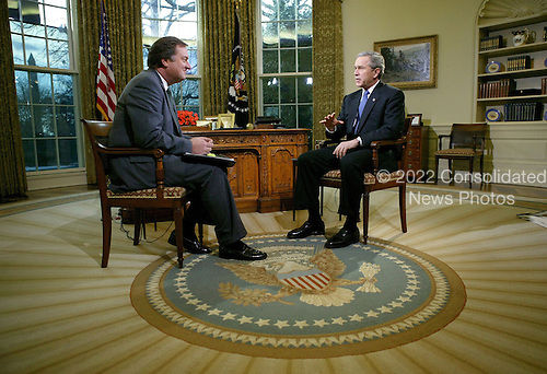 United States President George W. Bush speaks during an interview with Tim Russert for NBC's &quot;Meet the Press&quot; in the Oval Office, Saturday, February 7, 2004. <br /> Mandatory Credit: Eric Draper / White House via CNP