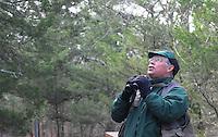 NWA Democrat-Gazette/FLIP PUTTHOFF<br /> Neal calls to birds Dec. 1, 2015 along the trail.