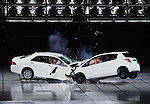 """July 21st, 2011, Susonosi, Japan - A Toyota Crown, left, collides head on with a Toyota VITZ at the speed of 55km/h (about 34 miles/h) in a demonstration at Toyotas Higashi-Fuji Technical Center on the foot of Mt. Fuji, some 92km (about 57 miles) southwest of Tokyo, on Thursday, July 21, 2011. Toyota showed to reporters technologies aimed at increasing safety for pedestrians and elderly drivers, as part of its initiatives to eliminate traffic casualties. The technologies include a Pre-Collision System with collision-avoidance assist, glare-preventing adaptive driving beams and a pop-up hood for lessening pedestrian injury. In the PCS, Toyota uses cameras and a super sensitive radar called """"millimeter-wave,"""" both installed in the front of the vehicle, to detect possible crashes such as a pedestrian crossing the road. Then the vehicle calculates how braking and steering must be applied to avoid a crash. (Photo by Natsuki Sakai/AFLO) [3615] -mis-"""