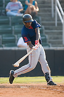 Shortstop Oscar Tejeda (5) of the Greenville Drive makes contact with the ball at Fieldcrest Cannon Stadium in Kannapolis, NC, Sunday August 10, 2008. (Photo by Brian Westerholt / Four Seam Images)