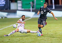 17th July 2020, Orlando, Florida, USA;  Real Salt Lake forward Justin Meram (9) try to block Minnesota United midfielder Ethan Finlay (13) from passing the ball during the MLS Is Back Tournament between the Real Salt Lake versus Minnesota United FC on July 17, 2020 at the ESPN Wide World of Sports, Orlando FL.