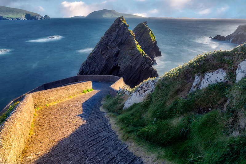 Road to Dunquin Pier with offshore rocks and winding road. County Kerry, Ireland