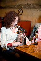 Gloria Mock (wife of owner Mr. Mouse) and Moonpie at the Cave in Chapel Hill, NC.