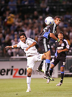 A.J. DeLAGarza (left) goes up for the header against Ryan Johnson (right). San Jose Earthquakes tied Los Angeles Galaxy 1-1 at the McAfee Colisum in Oakland, California on April 18, 2009.