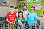 Cian Begley, Emma Lonergan and Jack Bambury, pictured with Kerry footballer Killian Young and Siobhan O'Shea were presented with vouchers after they were chosen as having the best smile in Kerry at the Dental Clinic in Tralee on Monday.