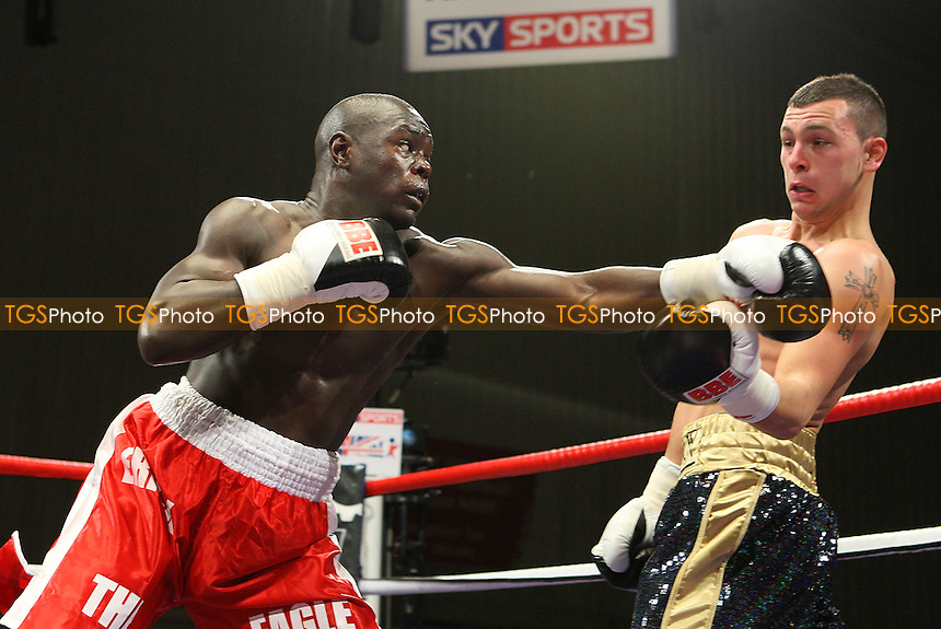 Erick Ochieng (red shorts) defeats Prince David Davis in a Middleweight boxing contest at the Harvey Hadden Leisure Centre, Nottingham, promoted by Frank Maloney - 20/11/09 - MANDATORY CREDIT: Gavin Ellis/TGSPHOTO - Self billing applies where appropriate - Tel: 0845 094 6026