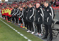 06 April 2013: Toronto FC head coach Ryan Nelsen and the rest of his coaching staff during the national anthems in an MLS game between FC Dallas and Toronto FC at BMO Field in Toronto, Ontario Canada..The game ended in a 2-2 draw..