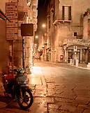 ITALY, Verona, illuminated street at Piazza Delle Erbe at night with Vespa