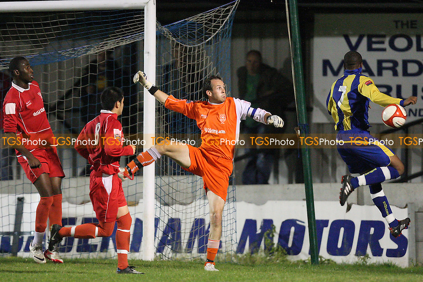 Ilford goalkeeper Roy Budd denies Aiden Clifton of Romford - Romford vs Ilford - Ryman League Division One North Football at Mill Field, Aveley FC - 27/09/11 - MANDATORY CREDIT: Gavin Ellis/TGSPHOTO - Self billing applies where appropriate - 0845 094 6026 - contact@tgsphoto.co.uk - NO UNPAID USE.