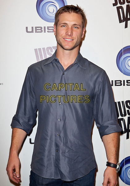 Jake Pavelka.Ubisoft Presents The Launch of Just Dance 3 held at The Beverly, Beverly Hills, California, USA..October 4th, 2011.half length blue shirt.CAP/ADM/ES.©Emiley Schweich/AdMedia/Capital Pictures.
