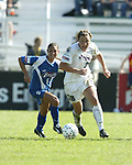 Abby Wambach (28) pulls away from Tiffany Roberts at SAS Stadium in Cary, North Carolina on 4/5/03 during a game between the Carolina Courage and Washington Freedom. The Washington Freedom won the game 2-1.