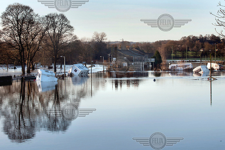 A community of between 20 and 30 people lost their homes as static caravans and mobile homes were swept from their pitches in the grounds of the Esholt Sports and Leisure Club by floodwaters from the River Aire, and deposited further downstream.