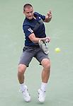 Mikhail Youzhny (RUS) defeats Jo Wilfried Tsonga (FRA) 6-1, 6-4