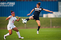 Sky Blue FC forward Kelley O'Hara (19) plays the ball as FC Kansas City midfielder Desiree Scott (11) watches during a National Women's Soccer League (NWSL) match at Yurcak Field in Piscataway, NJ, on June 26, 2013.