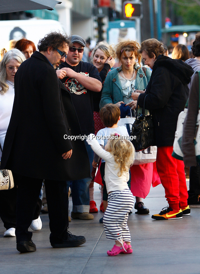 Exlcusive 12-19-08. Tim Burton took a picture with a U.P.S Man and stopped to talk with some fans then continued walking with Helena Bonham Carter, Kids, mother and other family members shopping on the Promenade in Santa Monica ca around 3:30pm??The entire family shops, Tim Burton waits for Helena and kids to shop in Brookstone. Then they all gather together cross the road and get in the family Navigator to leave.??Helena Bonhams mother, and so it seems other family members, wrangle the two Burton kids. The son wearing some great Burtonesque clothing, Helena wearing some funky heels with her usual clothing style. Smiles of the little girl being carried around by Helenas brother????A great Burton family outing...AbilityFilms@yahoo.com.805-427-3519.www.AbilityFilms.com.