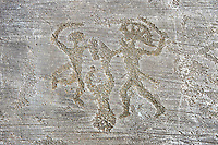 Petroglyph, rock carving, of two warriors fighting, the one on the right has a headress and they both have shields. Carved by the ancient Camunni people in the iron age between 1000-1200 BC. Rock no 6, Foppi di Nadro, Riserva Naturale Incisioni Rupestri di Ceto, Cimbergo e Paspardo, Capo di Ponti, Valcamonica (Val Camonica), Lombardy plain, Italy