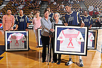 25 February 2012:  FIU's Jeremy Allen (32) presents a jersey to Bertha Russo, mother of FIU's Women's Basketball Head Coach Cindy Russo, during a ceremony honoring cancer survivors prior to the game.  The FIU Golden Panthers defeated the University of South Alabama Jaguars, 81-74, at the U.S. Century Bank Arena in Miami, Florida.