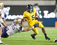 November 2nd, 2012: California's Brendan Bigelow tries to break a tackle by Washington's Sione Potoa'e during a game at Memorial Stadium, Berkeley, Ca Washington defeated California 21 -13