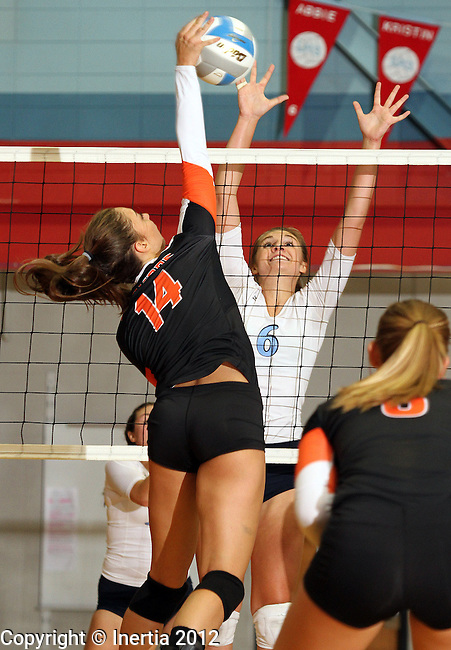 SIOUX FALLS, SD - SEPTEMBER 11: Abbie Jarratt #6 from Lincoln tries to block a kill attempt by Lexi Bordeaux #14 from Washington in the second set of their match Tuesday night at Lincoln High. (Photo by Dave Eggen/Inertia)