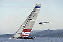 Louis Vuitton Trophy La Maddalena 3 giugno 2010. Synergy Russian Sailing Team naviga di bolina sotto lo sguardo attento di un elicottero durante i quarti di finale con Mascalzone Latino.