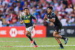 Rocky Khan of New Zealand (R) passes the ball during the HSBC Hong Kong Sevens 2018 Bronze Medal Final match between South Africa and New Zealand on 08 April 2018 in Hong Kong, Hong Kong. Photo by Marcio Rodrigo Machado / Power Sport Images
