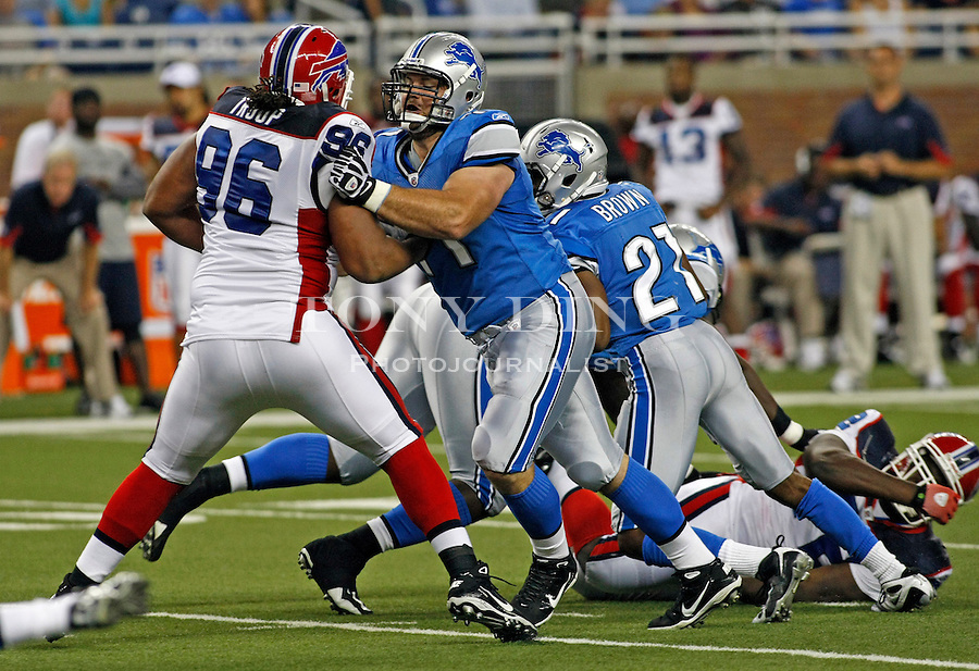 Detroit Lions guard Noah Franklin, center, blocks Buffalo Bills defensive tackle Torell Troup (96) for running back Aaron Brown (21), in the fourth quarter of a preseason NFL football game, Thursday,  Sept. 2, 2010, in Detroit. The Lions won 28-23. (AP Photo/Tony Ding)