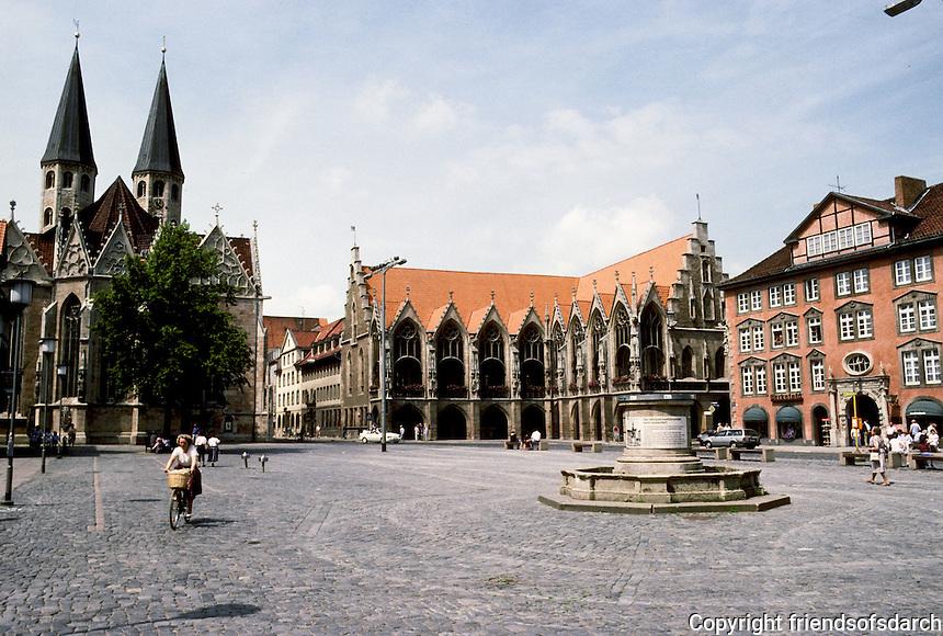 Braunschweig: Alstadtmarkt--ensemble. From left, St. Martin's, 13th C.; Town Hall 13-15 C.; lead fountain with 3 basins in center. Fountain erected 1408, destroyed 1944, restored 1951. Photo '87.