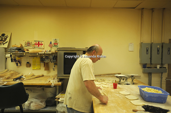 Basil Ushveridze, a Georgian immigrant and baker, begins baking traditional Georgian hachapuri bread at 8 a.m. at the Argo Georgian Bakery on West Devon Avenue in Chicago, Illinois on May 7, 2008.  Indian, Pakistani, Muslim and Jewish, Devon Avenue in the West Rogers Park neighborhood is an eclectic representation of the world.