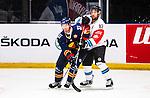 Stockholm 2014-08-21 Ishockey CHL Djurg&aring;rdens IF - Fribourg-Gotteron  :  <br /> Djurg&aring;rdens Mikael Samuelsson uppvaktas av Fribourg-Gotterons Michael Ngoy<br /> (Foto: Kenta J&ouml;nsson) Nyckelord:  Djurg&aring;rden Hockey Hovet CHL Fribourg Gotteron
