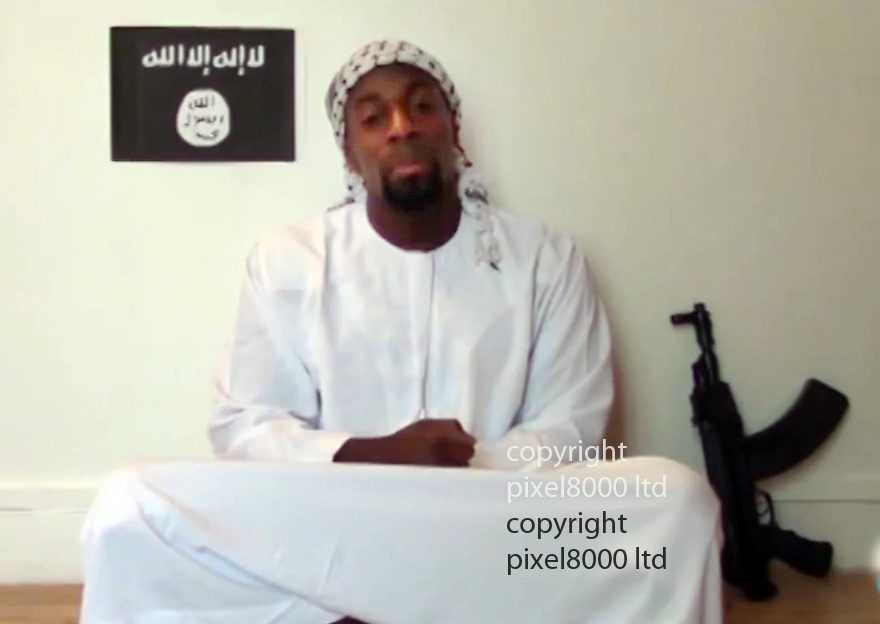 pic shows: video reportedly uploaded by Amedy Coulibaly to justify his actions in Paris where he took hostages in a kosher deli and finished up being shot by police.<br /> <br /> He is seen alternating between combat clothes and traditional muslim dress but with a gun beside him<br /> <br /> During the videos he speaks only French<br /> <br /> <br /> <br /> Picture by Pixel8000 07917221968