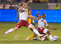 Landon Donovan Fwd of the LA Galaxy scores the winning goal of the match between New York Red Bull defenders Marvell Wynne, right, and Jeff Parke, left. LA Galaxy defeated New York 1-0 during a MLS game at The Home Depot Center in Carson, California, Tuesday July 4, 2006.