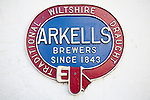 Close up of old metal advertising sign for Arkells brewers of traditional draught beer since 1843, Wiltshire, England