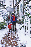 Mother and small child, walking on a winter sidewalk, Moorestown, New Jersey